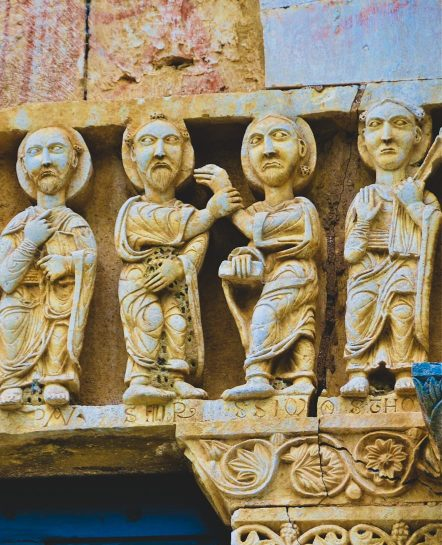 Small Italian statues on buildings