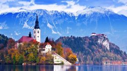 Mountains, cliffs, and church near Bled Lake in Slovenia