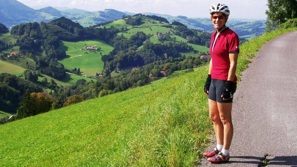 cyclist posing in front of Austrian countryside