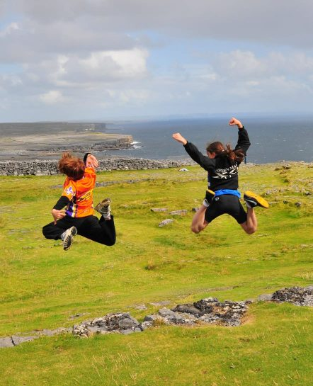 Youngsters jumping near Ireland coast