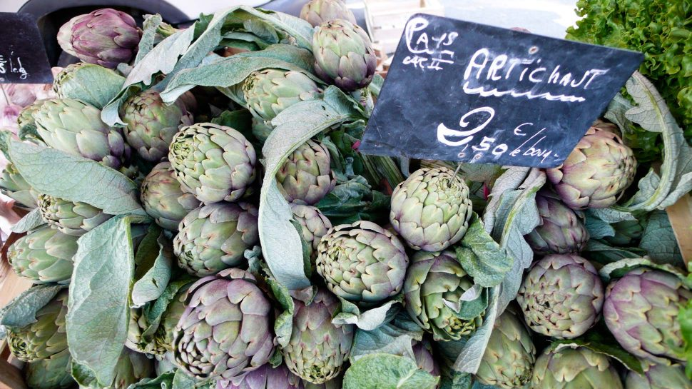 Artichokes at a farmer's market in Divine Provence