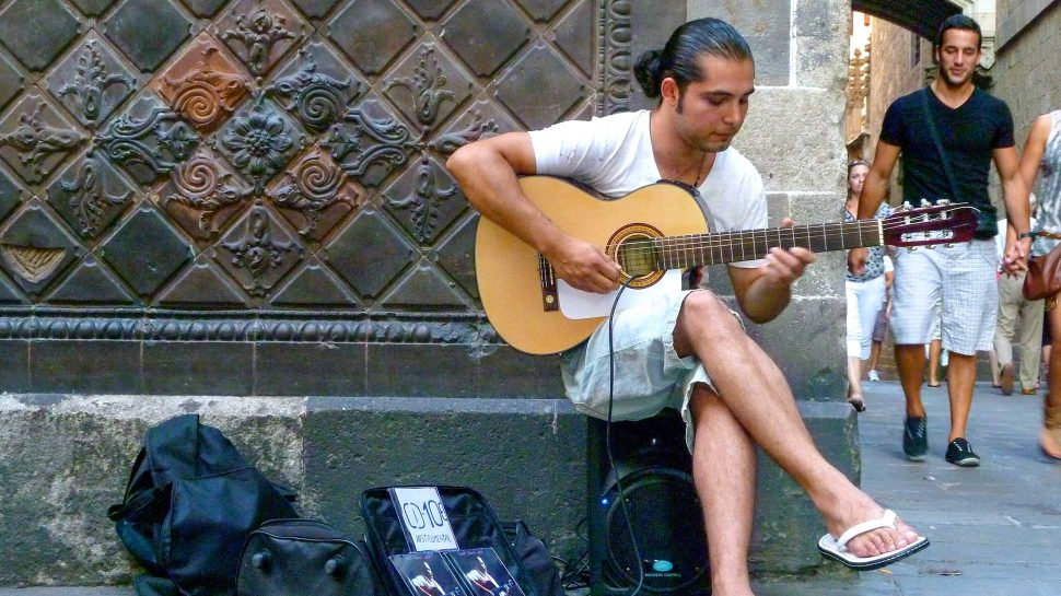 Spanish musician playing his guitar