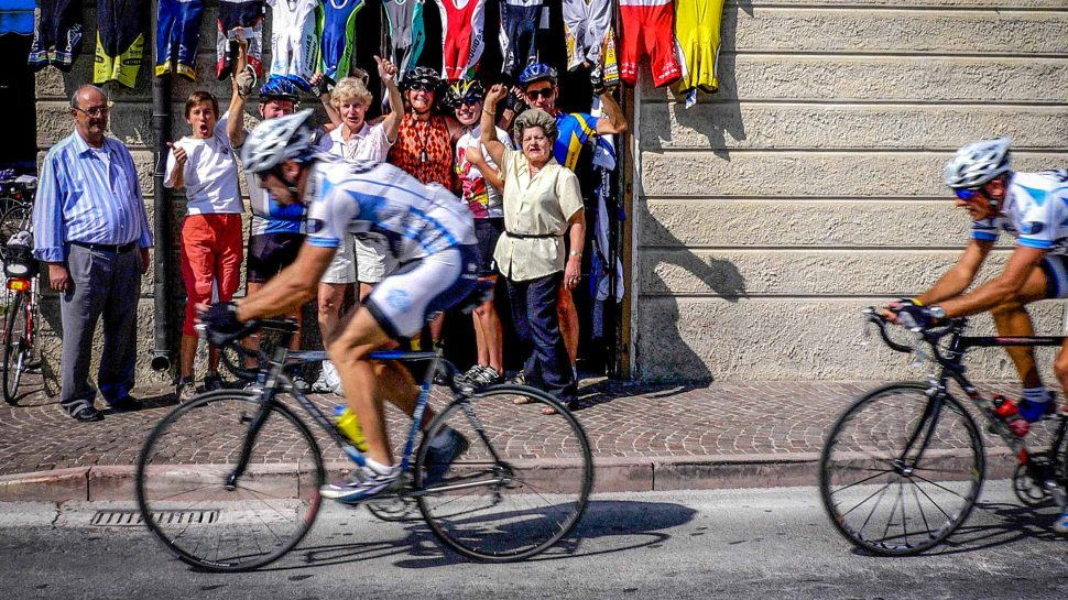 Locals cheering bikers in Sud Tyrol