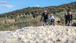 Bikers on a gravel road on the Via Francigena tour