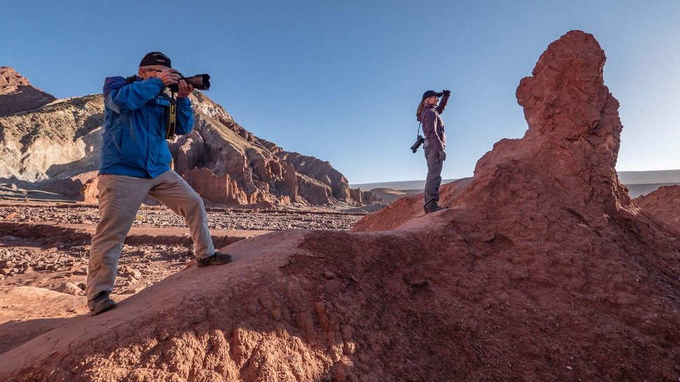 Man and woman photographing Chilean rocks