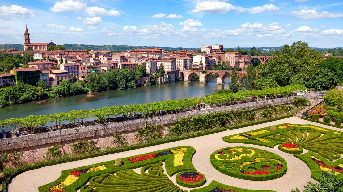 Flower garden in France with city in background