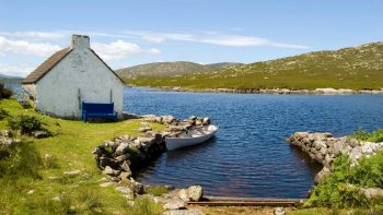 Cottage and canoe on Ireland's west coast