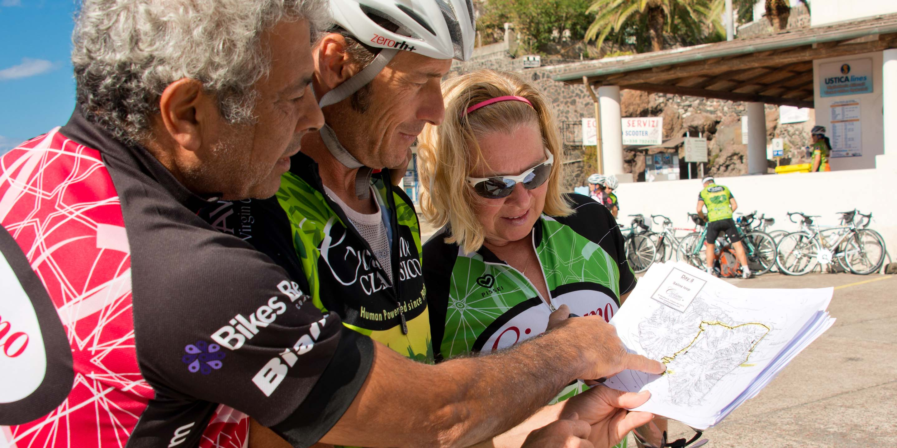 Bike tour guide planning route on map