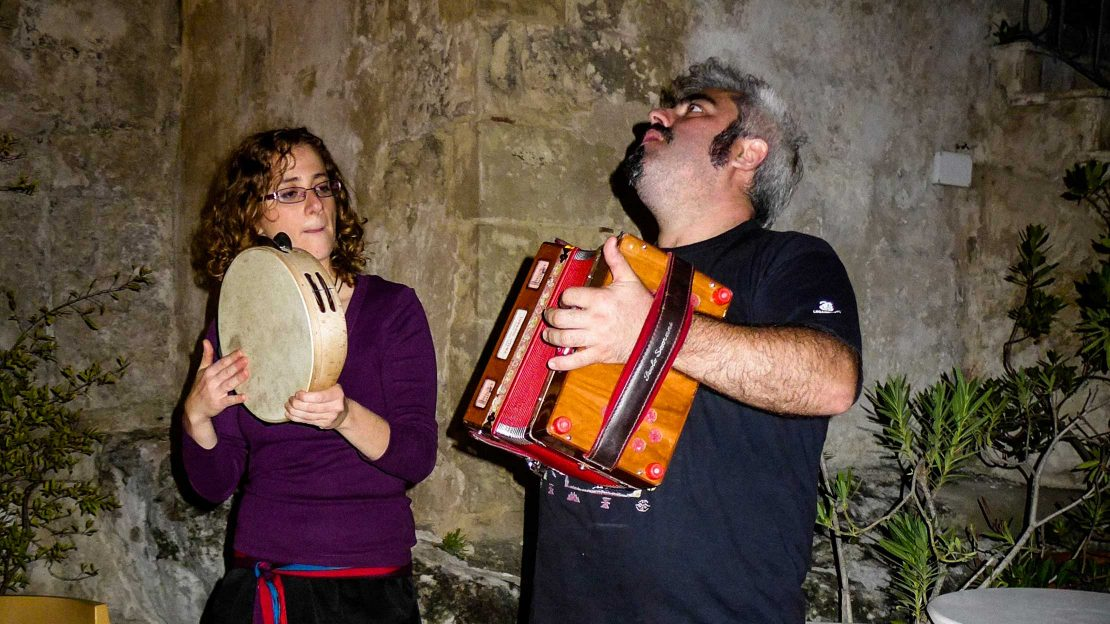 Tourist and local playing music