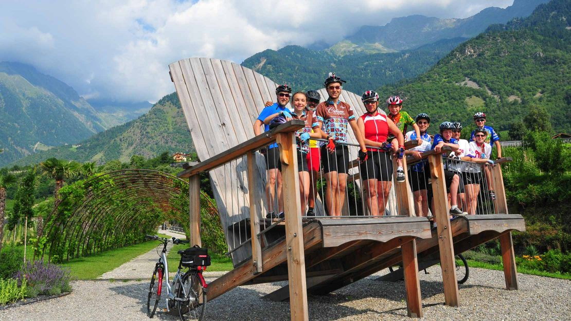 Group standing on a giant Adirondack chair in Sud Tyrol