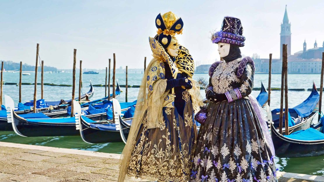 Women in Venetian costumes and masks