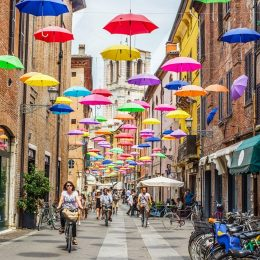 Venetian street with umbrellas hanging