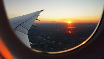Looking out a plane window at sunset
