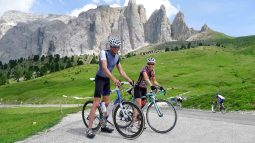 Bikers posing in front of mountains in the Dolomites