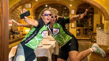Bikers having fun at restaurant in Tuscany