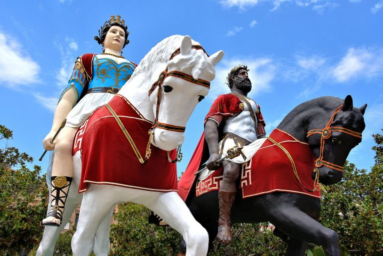 A photograph of horseback statues in the Procession of the Trapani Mysteries.