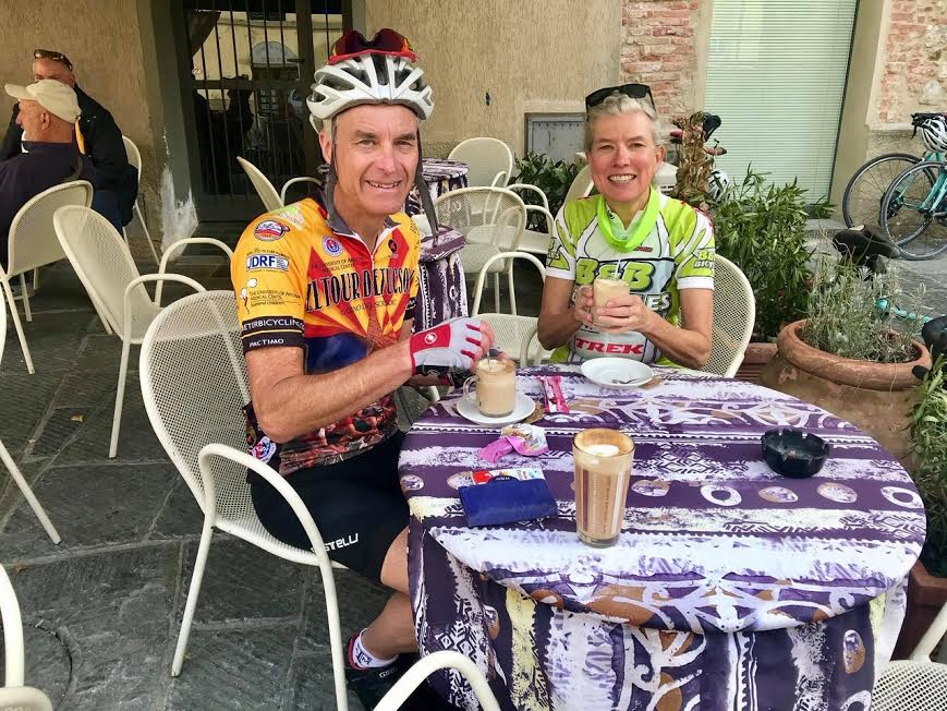 cyclists in italy stopping for coffee