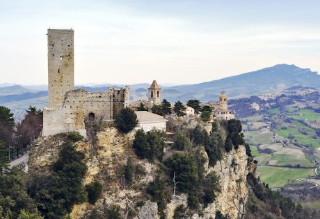 Medieval village with a castle perched on a rock in the province of Fermo,Marche,Italy.
